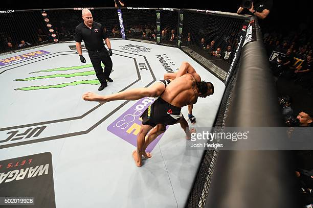 Charles Oliveira takes down Myles Jury in their featherweight bout during the UFC Fight Night event at the Amway Center on December 19 2015 in...