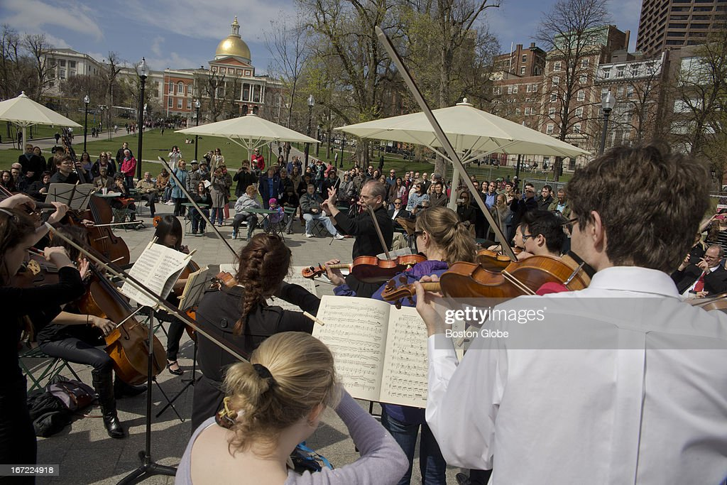 Charles Peltz conducts students from the New England Conservatory, as they perform Beethoven following a moment of silence for the victims of the Boston Marathon bombings, in the Boston Common near Park Street Station on Monday, April 22, 2013.