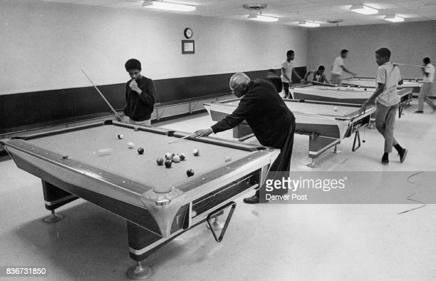 Charles Peoples Of 3360 Vine St Gets A Lesson In Playing Pool His instructor is Leonard L Duncan supervisor in the senior boys game room Credit...