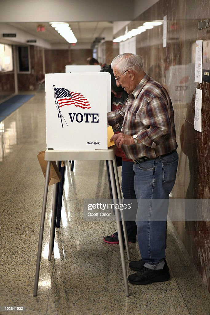Charles Peyton fills in his ballot during early voting at the Black Hawk County Courthouse on September 27, 2012 in Waterloo, Iowa. Early voting starts today in Iowa where in the 2008 election 36 percent of voters cast an early ballot.