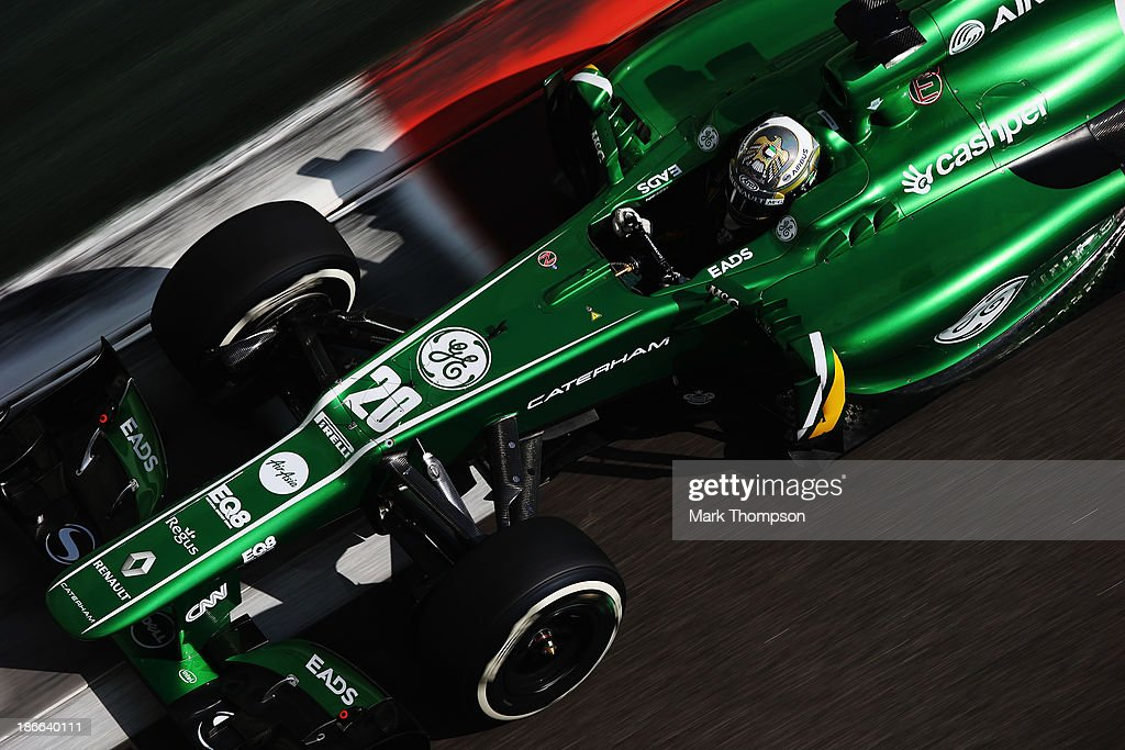 Charles Pic of France and Caterham drives during qualifying for the Abu Dhabi Formula One Grand Prix at the Yas Marina Circuit on November 2 2013 in...