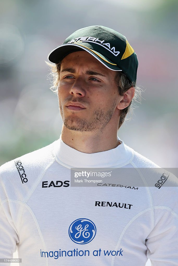Charles Pic of France and Caterham walks in the pitlane before practice for the Hungarian Formula One Grand Prix at Hungaroring on July 26 2013 in...