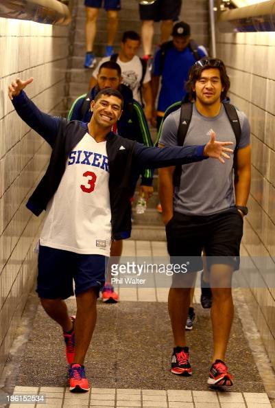 Charles Piutau and Steven Luatua of the All Blacks walk to a pool recovery session on October 29 2013 in Tokyo Japan