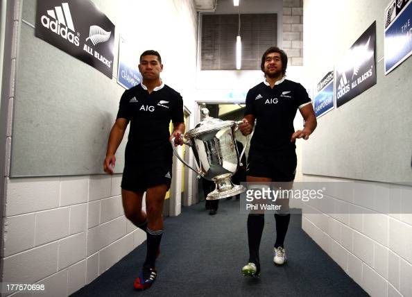Charles Piutau and Steven Luatua walk into the sheds with the Bledisloe Cup following The Rugby Championship Bledisloe Cup match between the New...