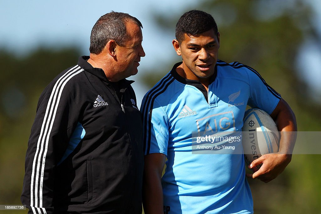 <a gi-track='captionPersonalityLinkClicked' href=/galleries/search?phrase=Charles+Piutau&family=editorial&specificpeople=7158787 ng-click='$event.stopPropagation()'>Charles Piutau</a> of the All Blacks gets tips from Assistant Coach Ian Foster during a New Zealand All Blacks training session at Waitakere Stadium on October 26, 2013 in Auckland, New Zealand.