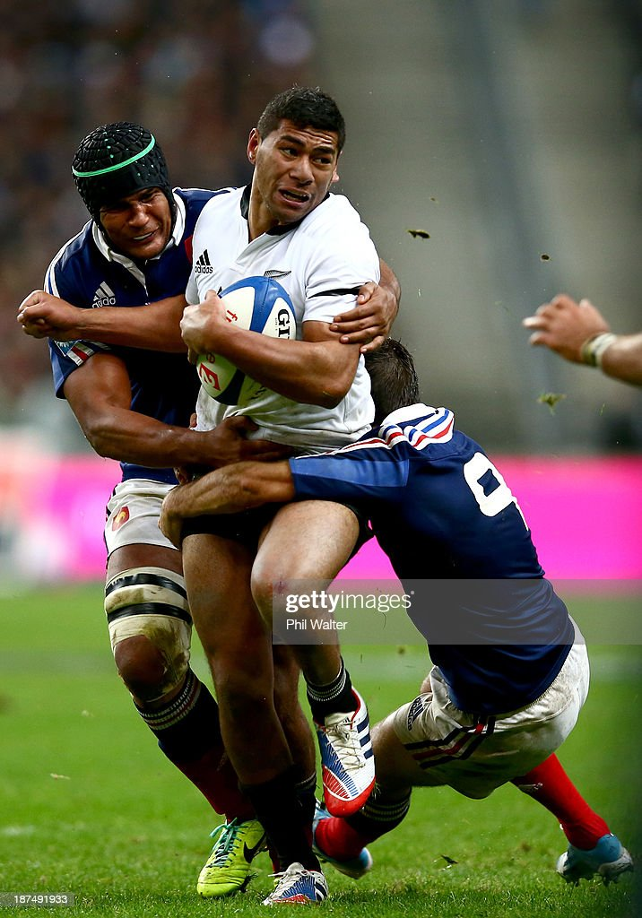 Charles Piutau of the All Blacks is tackled by Thierry Dusautoir of France during the international test match between France and the New Zealand All Blacks at Stade de France on November 9, 2013 in Paris, France.