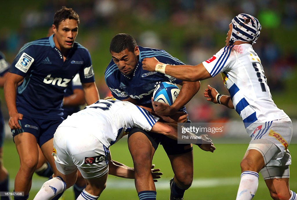 <a gi-track='captionPersonalityLinkClicked' href=/galleries/search?phrase=Charles+Piutau&family=editorial&specificpeople=7158787 ng-click='$event.stopPropagation()'>Charles Piutau</a> of the Blues is tackled by the Stormers defence during the round 12 Super Rugby match between the Blues and the Stormers at North Harbour Stadium on May 3, 2013 in Auckland, New Zealand.