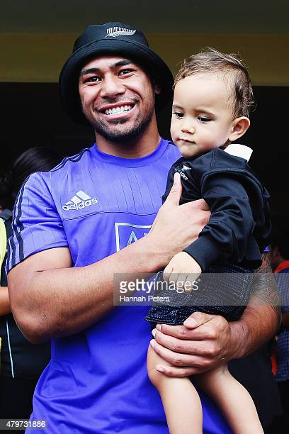 Charles Piutau of the New Zealand All Blacks holds a fan during visit to Marist Brothers Primary School on July 7 2015 in Apia Samoa