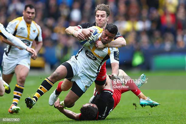 Charles Piutau of Wasps is tackled by Chris Wyles of Saracens during the European Rugby Champions Cup Semi Final between Saracens and Wasps at the...