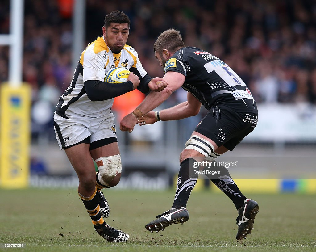 <a gi-track='captionPersonalityLinkClicked' href=/galleries/search?phrase=Charles+Piutau&family=editorial&specificpeople=7158787 ng-click='$event.stopPropagation()'>Charles Piutau</a> of Wasps is tackled by <a gi-track='captionPersonalityLinkClicked' href=/galleries/search?phrase=Geoff+Parling&family=editorial&specificpeople=820816 ng-click='$event.stopPropagation()'>Geoff Parling</a> during the Aviva Premiership match between Exeter Chiefs and Wasps at Sandy Park on May 1, 2016 in Exeter, England.