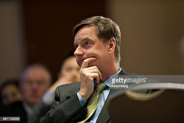 Charles Plosser chairman of the Federal Reserve Bank of Chicago listens during a speech by Janet Yellen chair of the US Federal Reserve not pictured...