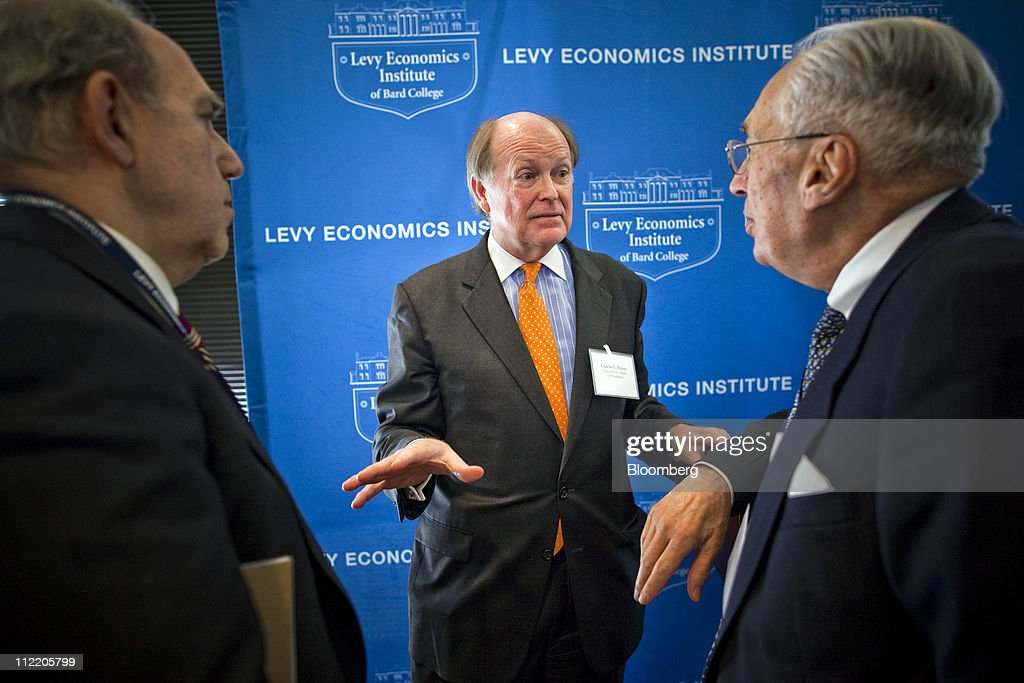 Charles Plosser, president and chief executive officer of the Federal Reserve Bank of Philadelphia, center, speaks with attendees after speaking at the Levy Economics Institute conference in New York, U.S., on Thursday, April 14, 2011. Plosser said the U.S. central bank should set a numerical inflation target to promote price stability as it prepares to withdraw record monetary stimulus. Photographer: Michael Nagle/Bloomberg via Getty Images