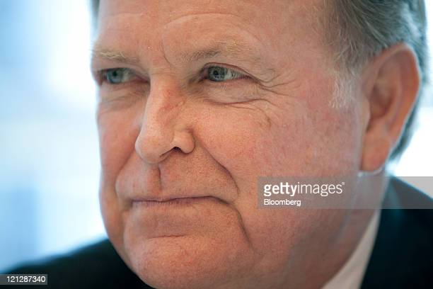 Charles Plosser president and chief executive officer of the Federal Reserve Bank of Philadelphia pauses during an interview in New York US on...