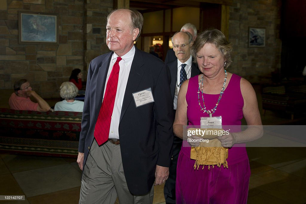<a gi-track='captionPersonalityLinkClicked' href=/galleries/search?phrase=Charles+Plosser&family=editorial&specificpeople=6564347 ng-click='$event.stopPropagation()'>Charles Plosser</a>, president and chief executive officer of the Federal Reserve Bank of Philadelphia, arrives with his wife Janet for an opening dinner during an economic symposium sponsored by the Kansas City Federal Reserve Bank at the Jackson Lake Lodge in Moran, Wyoming, U.S., on Thursday, Aug. 25, 2011. Federal Reserve Chairman Ben S. Bernanke may disappoint stock investors betting on a commitment to step up stimulus when he makes remarks at the annual Fed symposium tomorrow. Photographer: Daniel Acker/Bloomberg via Getty Images
