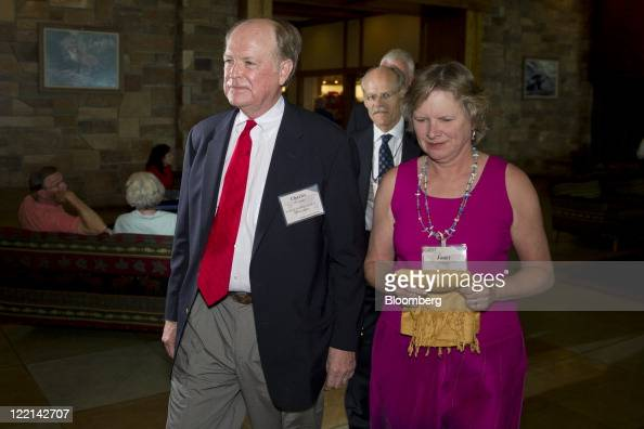Charles Plosser president and chief executive officer of the Federal Reserve Bank of Philadelphia arrives with his wife Janet for an opening dinner...