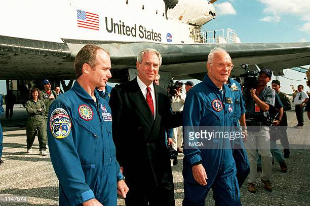 Charles Precourt chief of the Astronaut office in Houston and Daniel Goldin NASA administrator welcome back to Earth Senator John H Glenn Jr from a...