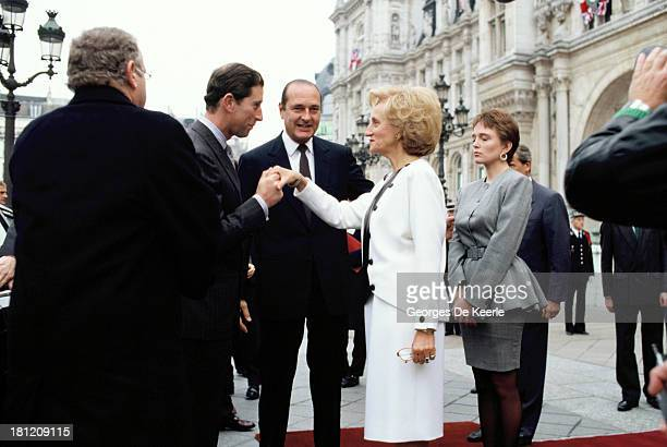 Charles Prince of Wales greets former French President Jacques Chirac and his wife Bernadette Chirac at Hotel de Ville during the official royal...