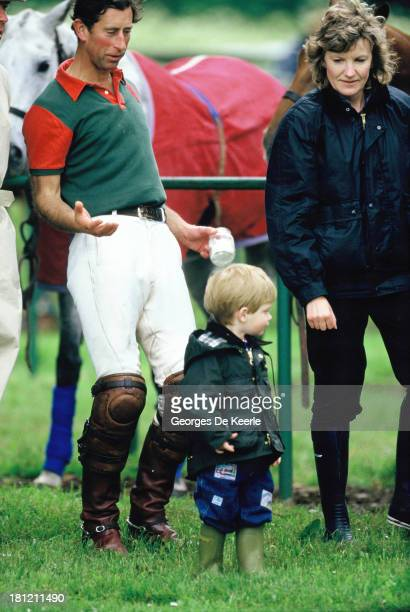 Charles Prince of Wales Prince Harry and his nanny Ruth Wallis during a polo match at Cirencester Polo Club on June 6 1987 in Cirencester England