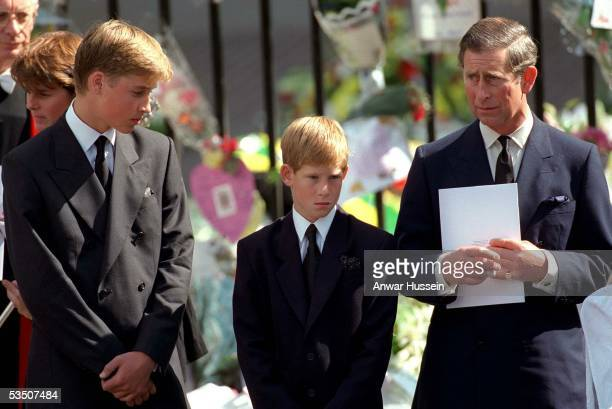 Charles Prince of Wales Prince William and Prince Harry stand outside Westminster Abbey at the funeral of Diana Princess of Wales on September 6 1997...