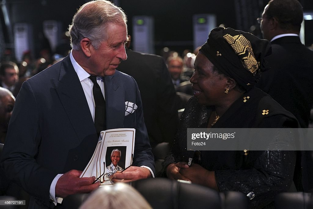 Charles, Prince of Wales with Nkosazana Dlamini-Zuma during Madiba's State Funeral on December 15, 2013 in Qunu, South Africa. Nelson Mandela passed away on the evening of December 5, 2013 at his home. He is laid to rest at his homestead in Qunu during a State Funeral.