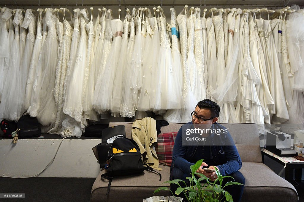 Charles Qian, from Shenzhen in China, waits as his fiance Echo Li, also from Shenzhen, has make-up applied as they prepare for pre-wedding photographs next to London landmarks, on October 11, 2016 in London, England. It's a Chinese custom for couples to have their wedding photos taken before they are married and on the wedding day the photos will be shown to guests on cards and big screens. Photography studios such as J.R Studios in east London have seen business boom as the capital has become increasingly popular as a location for pre-wedding photography thanks in part to its instantly recognisable landmarks.