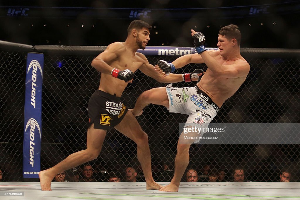Charles Rosa (R) fights against Yair Rodriguez (L) during a UFC Featherweight Fight between Charles Rosa and Yair Rodriguez at Arena Ciudad de Mexico on June 13, 2015 in Mexico City, Mexico.