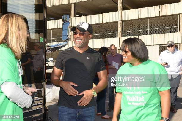 Charles Russell Darius Rucker and Shari Hinton talk at Ply Gem's Home for Good press conference with Habitat for Humanity on June 7 2017 in Nashville...