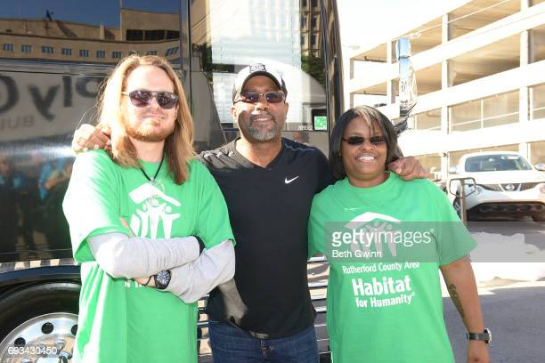 Charles Russell Darius Rucker Shari Hinton pose at Ply Gem's Home for Good press conference with Habitat for Humanity on June 7 2017 in Nashville...