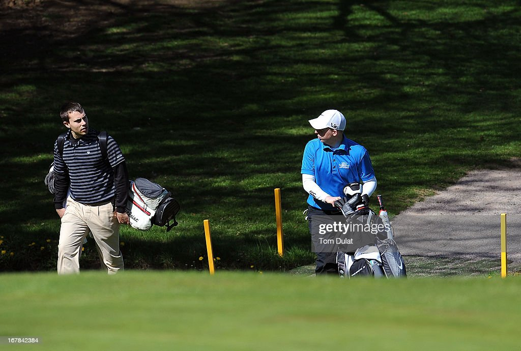 Charles Sandison-Woods (L) and James Sibbles of The Grove (R) chat during the Powerade PGA Assistants' Championship East Regional Qualifier at Chigwell Golf Club on May 01, 2013 in Chigwell, England.