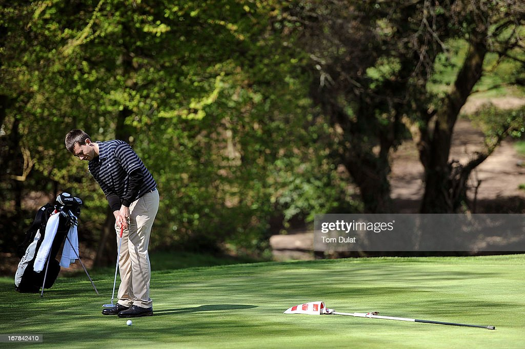 Charles Sandison-Woods plays a putt on the 6th green during the Powerade PGA Assistants' Championship East Regional Qualifier at Chigwell Golf Club on May 01, 2013 in Chigwell, England.