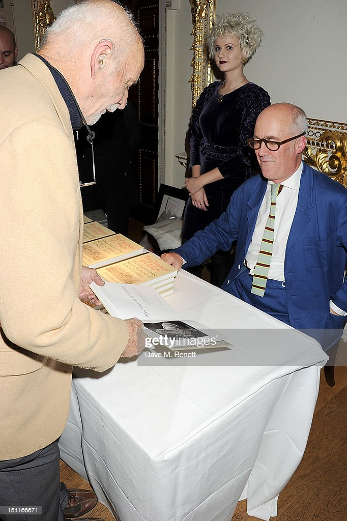 Charles Saumarez Smith (R), Chief Executive of the Royal Academy of Arts, signs copies of his new book 'The Company Of Artists: The Origins Of The Royal Academy Of Arts In London' at The Royal Academy of Arts on October 15, 2012 in London, England.