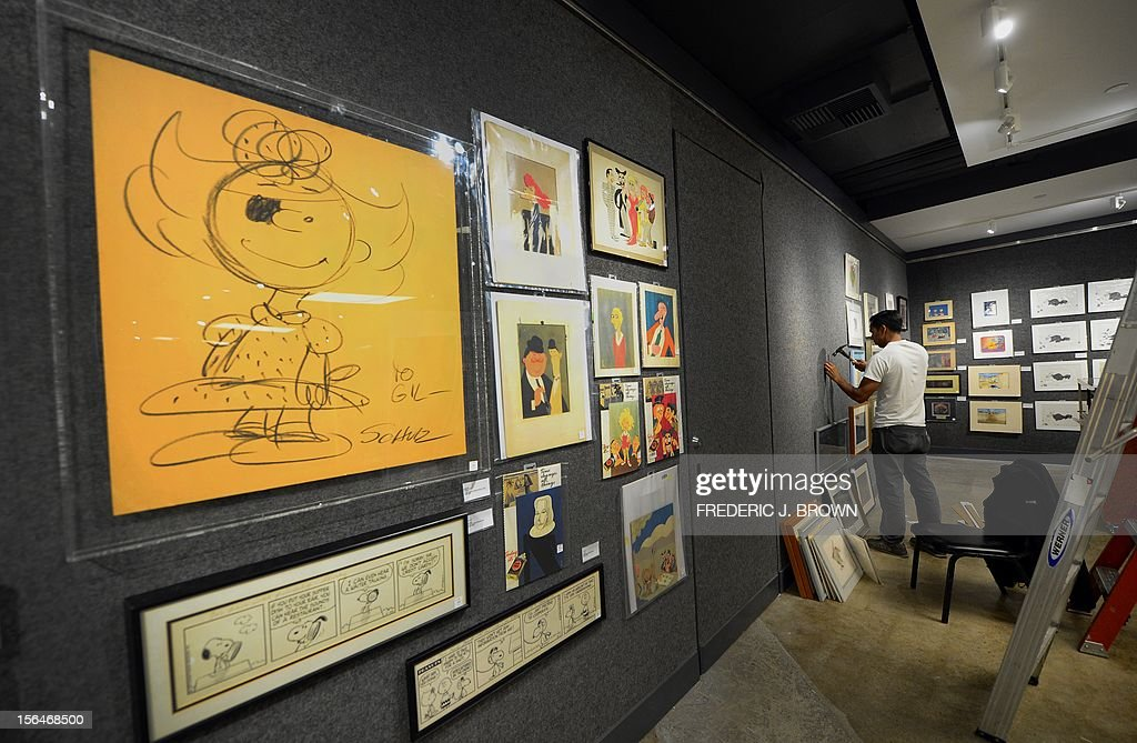 'MANDATORY MENTION OF THE ARTIST UPON PUBLICATION' A Charles Schulz large drawing of 'Sally', black crayon on paper, estimated between $2,000 and $3,000, is displayed during a press preview at auction house Bonham's in Hollywood, California, on November 15, 2012, where Charlie Chaplin's iconic bowler hat and cane are to go under the hammer in this weekend as part of an auction which also includes the John Lennon nude drawing of himself and Yoko Ono, part of the Lennon lot estomated between $18,000 and $22,000 , among memorabilia from other artists. The hat and cane trademark of Chaplin's Little Tramp character are in 'remarkable condition' and are estimated to go for between $40,000 and $60,000 at the sale by auction house Bonhams on Sunday November 18. AFP PHOTO / Frederic J. BROWN == RESTRICTED