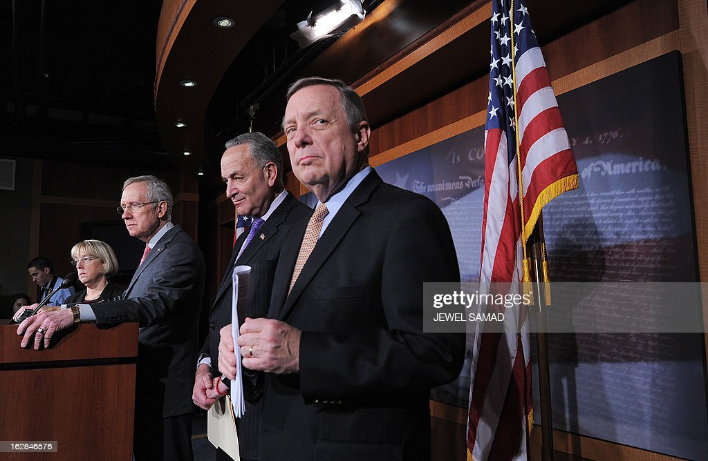 Charles Schumer (D-NY), Senate Majority Leader Harry Reid (D-NV) and Senate Majority Whip Richard Durbin (D-IL) hold a news conference at the US Capitol on the eve of the budget sequester on February 28, 2013 in Washington, DC. The broad US 'sequester' spending cuts that take effect beginning Friday will slow growth in the world's biggest economy and hit the global economy, the International Monetary Fund said Thursday. AFP PHOTO/Jewel Samad