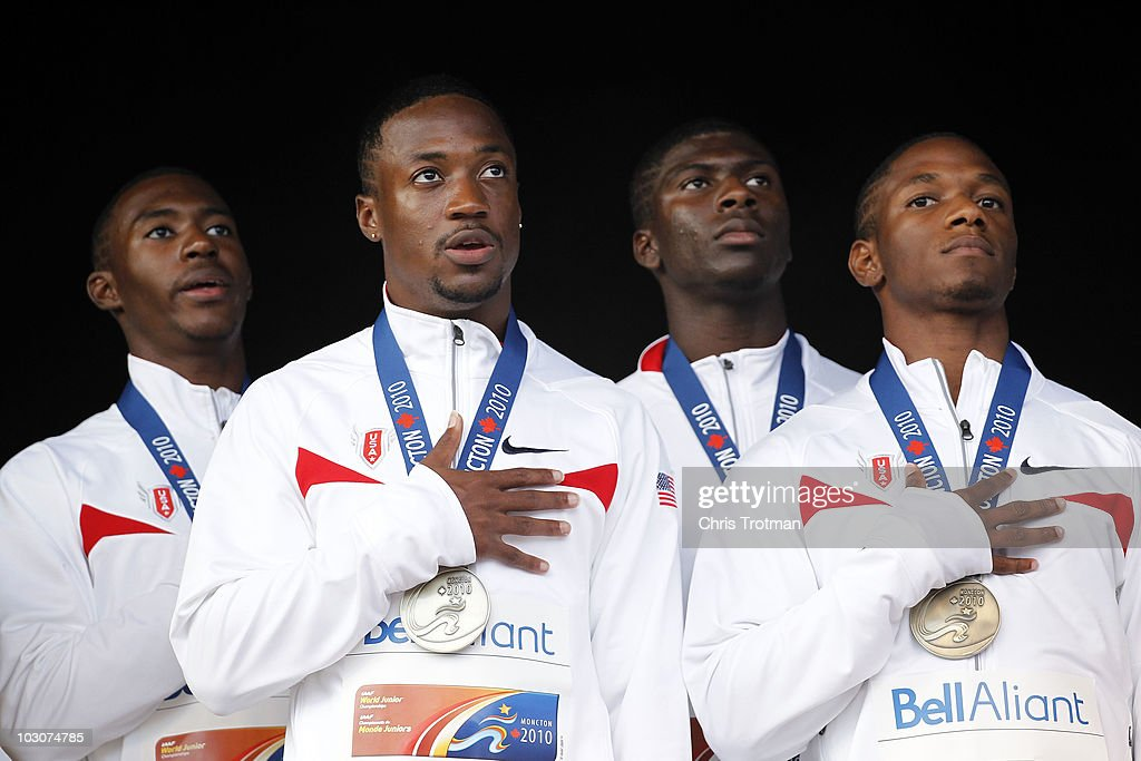 Charles Silmom Eric Harris Oliver Bradwell and Michael Granger of the United States stand on the medal podium following their victory in the Men's...
