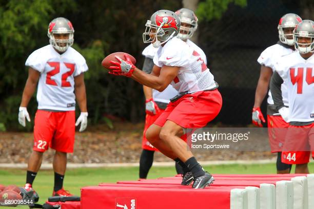 Charles Sims III smiles as he prepares to make a catch of the football during the Tampa Bay Buccaneers OTA on May 25 2017 at One Buccaneer Place in...
