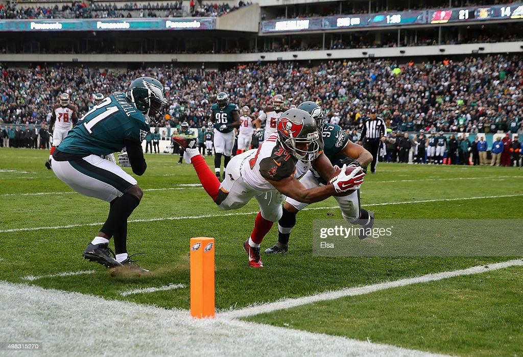 Charles Sims #34 of the Tampa Bay Buccaneers scores a touchdown against Byron Maxwell #31 and Mychal Kendricks #95 of the Philadelphia Eagles in the second quarter at Lincoln Financial Field on November 22, 2015 in Philadelphia, Pennsylvania.