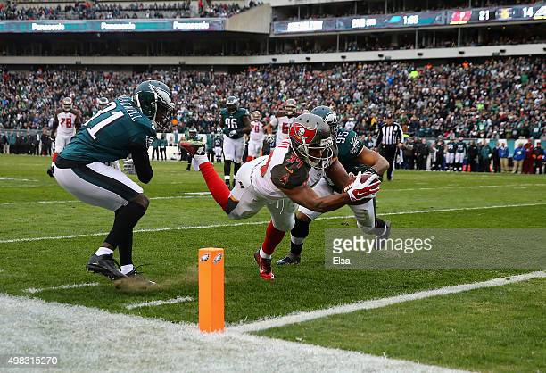Charles Sims of the Tampa Bay Buccaneers scores a touchdown against Byron Maxwell and Mychal Kendricks of the Philadelphia Eagles in the second...