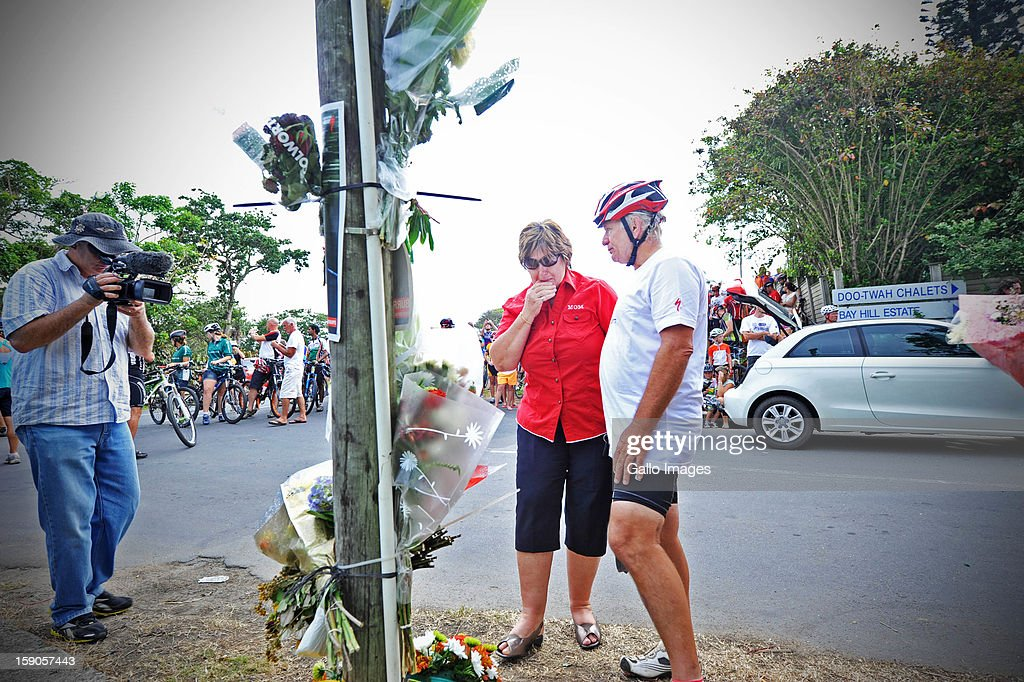 Charles Stander, Burry's father and his mother, Mandie Stander, comfort each other at the sight of the accident, where Burry Stander lost his life, on January 6, 2013 in Balito, South Africa. Burry was hit by a taxi while out on a training ride, he suffered severe head trauma and a broken neck, he was killed on impact. The taxi driver has been charged with culpable homicide.