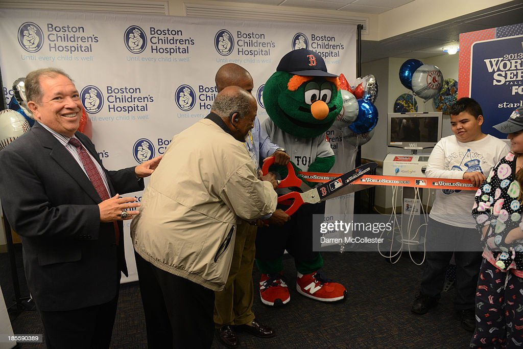 Charles Steinberg, EVP and Senior Advisor to the President and CEO, Boston Red Sox, and former Red Sox great Luis Tiant celebrate World Series with Boston Children's Hospital Starlight Fun Center Donation at Boston Children's Hospital on October 22, 2013 in Boston, Massachusetts.