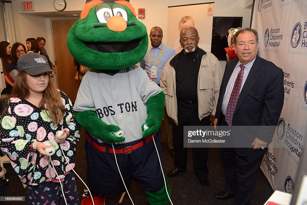 Charles Steinberg (R), EVP and Senior Advisor to the President and CEO, Boston Red Sox, and former Red Sox great Luis Tiant celebrate World Series with Boston Children's Hospital Starlight Fun Center Donation along with Wally and Janelle at Boston Children's Hospital on October 22, 2013 in Boston, Massachusetts.