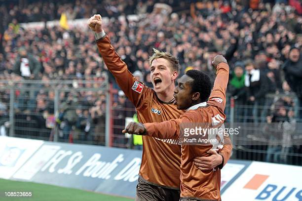 Charles Takyi and Bastian Oczipka of St Pauli celebrate the second goal during the Bundesliga match between FC St Pauli and 1 FC Koeln at Millerntor...