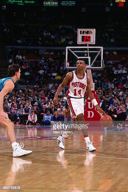 Charles Thomas of the Detroit Pistons handles the ball against the Charlotte Hornets circa 1991 at The palace of Auburn Hills in Auburn Hills MI NOTE...