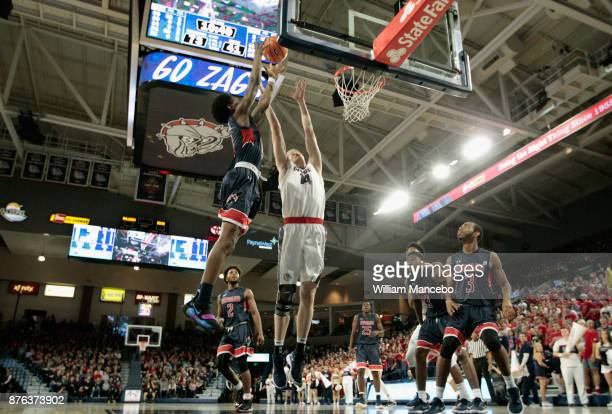 Charles Williams of the Howard Bison goes up to rebound against Jacob Larsen of the Gonzaga Bulldogs in the second Half at McCarthey Athletic Center...