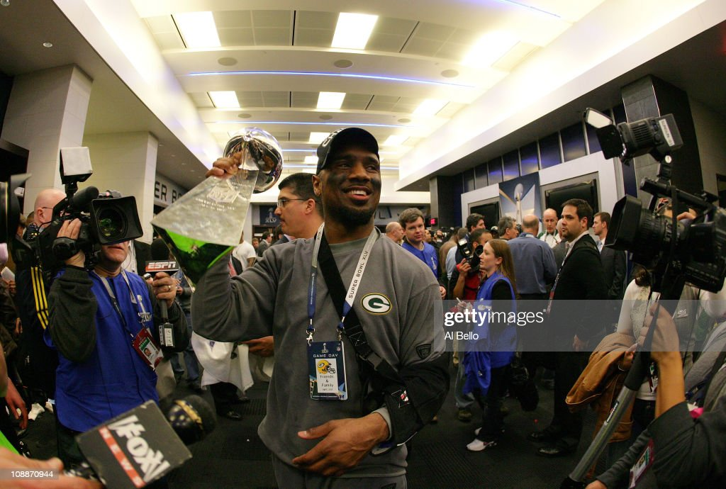 <a gi-track='captionPersonalityLinkClicked' href=/galleries/search?phrase=Charles+Woodson&family=editorial&specificpeople=218111 ng-click='$event.stopPropagation()'>Charles Woodson</a> #21 of the Green Bay Packers celebrates in the locker room with the Vince Lombardi Trophy after winning Super Bowl XLV 31-25 against the Pittsburgh Steelers at Cowboys Stadium on February 6, 2011 in Arlington, Texas.