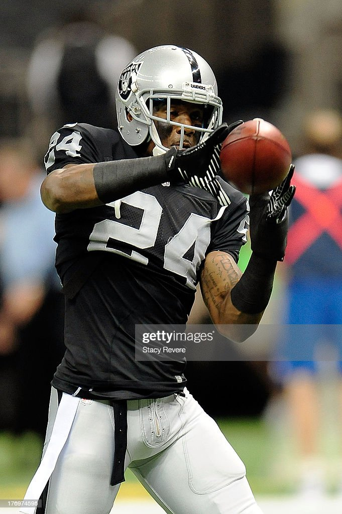 Charles Woodson #24 of the Oakland Raiders participates in warm-ups prior to a preseason game at the Mercedes-Benz Superdome on August 16, 2013 in New Orleans, Louisiana. The Saints won 28-20.