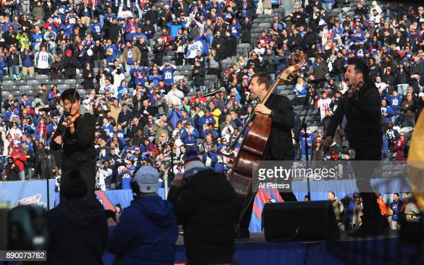 Charles Yang Ranaan Meyer and Nick Kendal of Time For Three perform the National Anthem before the Dallas Cowboys vs New York Giants game at MetLife...