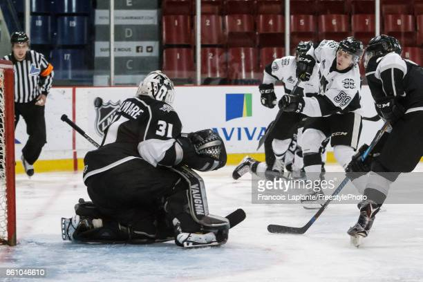 CharlesAntoine Giguere of the BlainvilleBoisbriand Armada shoots the puck past Mathieu Bellemare of the Gatineau Olympiques to score his first period...