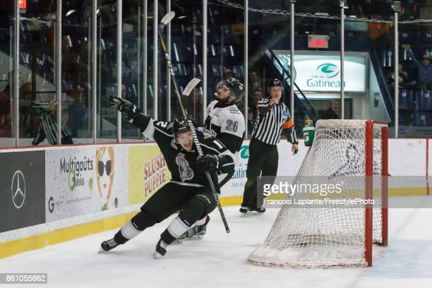 CharlesAntoine Roy of the Gatineau Olympiques celebrates his second period goal as Ryan DaSilva of the BlainvilleBoisbriand Armada reacts on October...