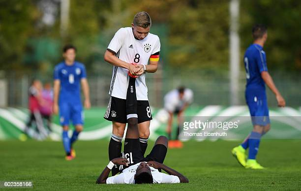 CharlesJesaja Herrmann of Germany gets help from teammate Erik Majetschak during the Under 17 four nations tournament match between U17 Germany and...