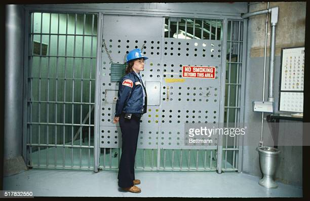 Security guard monitors a locked gate that leads to the reactor containment building at Consumers Power Company's Big Rock Point unclear plant The...